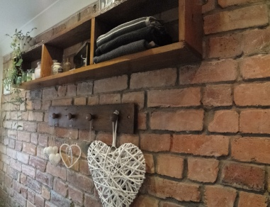 Vintage bathroom design exposed brick wall